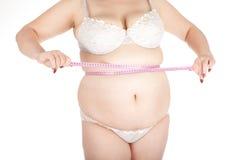 Messender Bauch der fetten Frau Stockfotografie