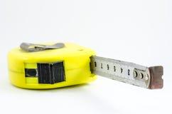 Messendes Band des gelben Kastens Lokalisiert im Weiß Lizenzfreie Stockbilder