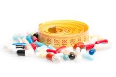 Messendes Band mit Pillen für herum nähren Stockfotografie