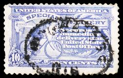Messenger on Bike, Special Delivery serie, circa 1917. MOSCOW, RUSSIA - MARCH 23, 2019: A stamp printed in United States shows Messenger on Bike, Special stock image