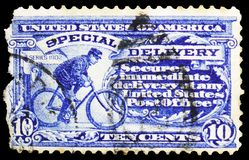 Messenger On Bike, Special Delivery serie, circa 1917. MOSCOW, RUSSIA - MARCH 23, 2019: A stamp printed in United States shows Messenger On Bike, Special stock photo