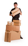 Messenger and cardboard boxes Royalty Free Stock Photo