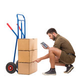 Messenger checking the delivery Royalty Free Stock Image