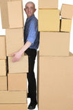 Messenger clamping between cardboard boxes Stock Images