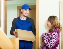 Messenger delivered box to housewife Royalty Free Stock Photography