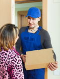 Messenger delivered box to woman Royalty Free Stock Photos