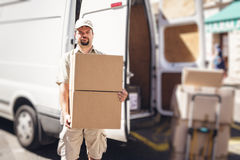 Messenger Delivering Parcel, Standing Next To His Van Royalty Free Stock Photo
