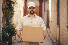 Messenger Delivering Parcel. Standing in the street of a french town stock image