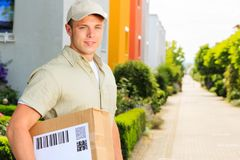 Delivery Boy In Residential Area Royalty Free Stock Images