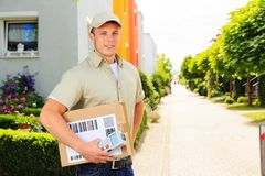Delivery Boy In Residential Area Royalty Free Stock Photography