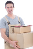 Messenger in dungarees with a lot of boxes Stock Images