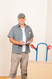 Messenger mature male courier delivering parcels Royalty Free Stock Photos