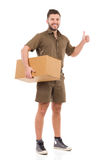 Messenger with a package giving thumb up Stock Photography