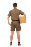 Messenger with a package. Rear view. Royalty Free Stock Images