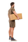 Messenger with a package. Side view Royalty Free Stock Photo