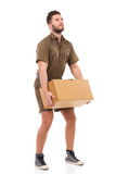 Messenger picking up a package. Royalty Free Stock Photography