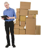 Messenger and pile of cardboard boxes Stock Photography