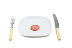 Messer, Bolzen und Platte mit Scheibe der Wurst Stockbild