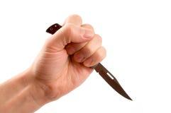 Messer in der Hand Lizenzfreie Stockfotos