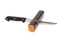 Messer in einem Bleistiftspitzer lokalisiert Stockfotos