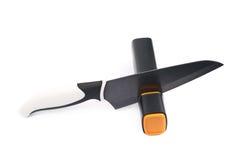 Messer in einem Bleistiftspitzer lokalisiert Stockfotografie