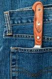 Messer in einer Tasche Lizenzfreies Stockbild
