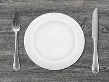 Messer, Gabel und Platte Stockbilder
