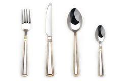 Messer, Gabel und zwei Löffel Stockfoto