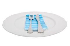Messer und Gabel auf einer Platte Stockbild