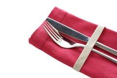 Messer und Gabel mit rosafarbener Serviette Stockbild