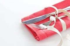 Messer und Gabel mit Tangerineserviette Lizenzfreie Stockbilder