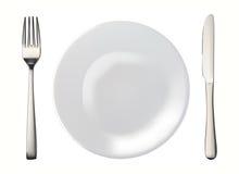 Messer, weiße Platte und Gabel getrennt lizenzfreies stockbild