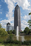 Messeturm, pond and fountain in the Friedrich Ebert plant in Frankfurt, Germany.  Stock Image