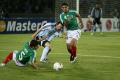 Messi and Marquez. Here you can see lionel messi fighting for a ball whith Rafa Marquez royalty free stock image