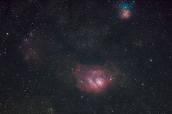 Messier 8 Lagoon nebula and Messier 20 Trifid nebula. Taken with dedicated astrophotography camera on the telescope stock image