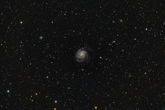Messier 101 Pinwheel Galaxy in Ursa Major. Messier 101 is named a Pinwheel Galaxy. In NGC catalog has a 5457 number. Is a face on spiral galaxy in the Ursa Major stock photography