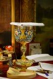 Messkelch für Kommunion im orthodoxen Kloster kiew Lizenzfreie Stockbilder
