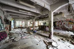 Messy abandoned factory room Royalty Free Stock Photo