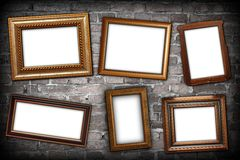 Messy arrangement of frames on wall Stock Photos