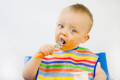 Messy Babies First Foods Royalty Free Stock Photography
