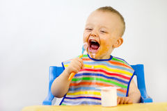 Messy Babies Food Round Face Stock Photo