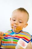 Messy Baby Checks Calorie Content Stock Images