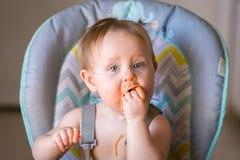 Messy baby girl love`s spaghetti Stock Photo