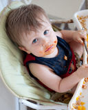 Messy Baby in High Chair Stock Photo
