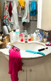 Messy bathroom. Sink with stained mirror stock image