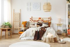 Messy bed in bedroom. Messy king-size bed with warm blankets in the bedroom stock images