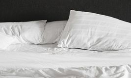 Messy bed sheet and pillows Royalty Free Stock Image