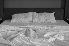 Messy bed sheets and pillow. Detail of messy bed sheets and pillow in Hotel royalty free stock image