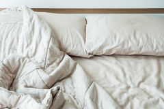 Messy bed with two pillows in the morning. Stock Image