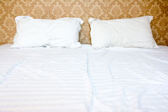 Messy bed with two pillows Royalty Free Stock Images